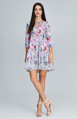 Sukienka w kolorowe kwiaty wiązana pod szyją