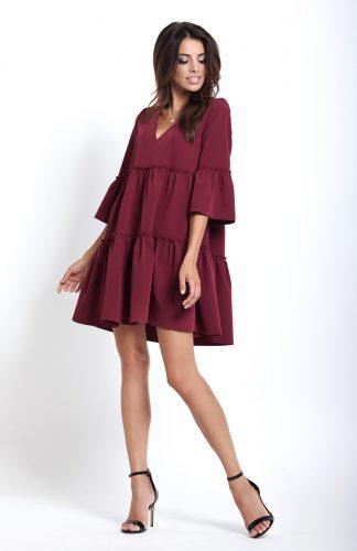 Elegancka sukienka do kolan z falbanami bordowa